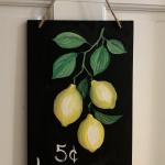 E24  Lemons on Chalkboard Sign