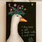 B40  Margaret the Goose on chalkboard sign